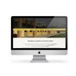 Il sito internet aziendale che abbiamo realizzato per Donnalucia.it. Monitor mac con la home page di scuderia donna lucia